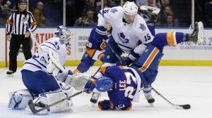 Toronto Maple Leafs' Paul Ranger (15) checks New York Islanders' Anders Lee (27) in front of Jonathan Bernier.