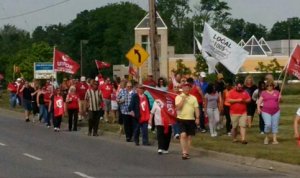 Just over a hundred Unifor supporters marching over to Cambridge Toyota gates.