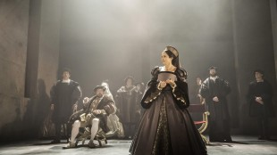 "This photo provided by Jeffrey Richards Associates shows, from left, Ben Miles (standing) as William Cromwell, Nathaniel Parker (seated) as Henry VIII and Lydia Leonard as Anne Boleyn, in a scene from The Shakespeare Company production of Mantel's ""Wolf Hall,"" directed by Jeremy Herinn. (Johan Persson/Jeffrey Richards Associates via AP)"