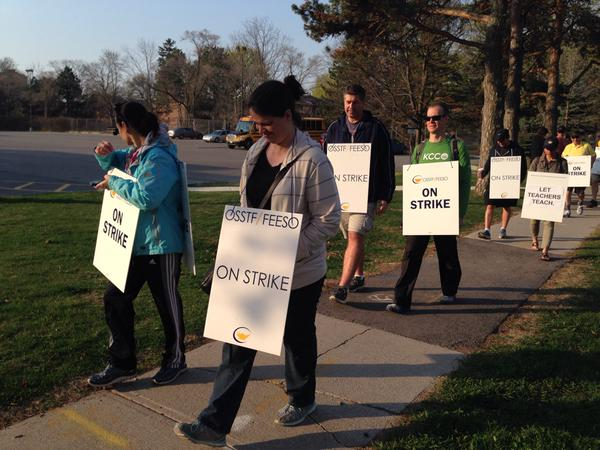 Teachers on strike outside public high schools in Peel Region. Photo courtesy of @carl680
