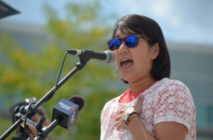 """Kitchener artist in residence, Janice Lee speaking  """"Bare with Us: Top Freedom Rally at Waterloo Town Square, Aug 1, 2015"""