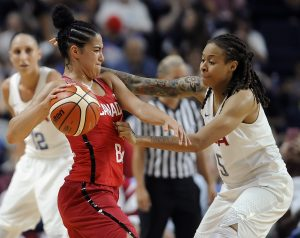 Canada's Kia Nurse, front left, is pressured by United States' Seimone Augustus during the second half of a women's exhibition basketball game, Friday, July 29, 2016, in Bridgeport, Conn. (AP Photo/Jessica Hill)