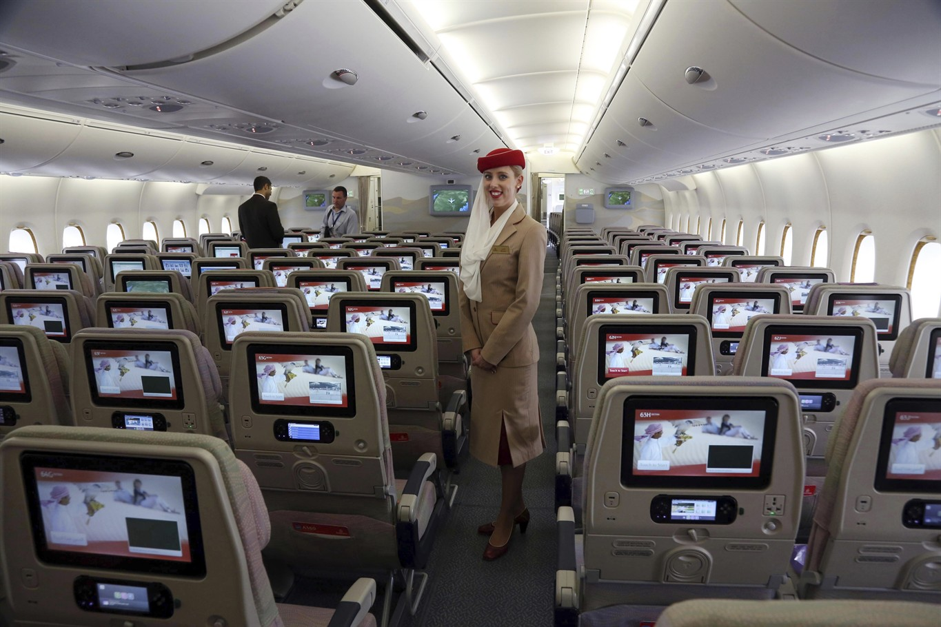 FILE In This Wednesday March 12 2014 File Photo A Stewardess Stands Inside An Emirates A380 Aircraft The Worlds Largest Passenger Airline