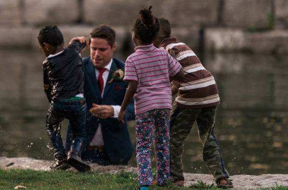 Groom jumps into river to save drowning boy