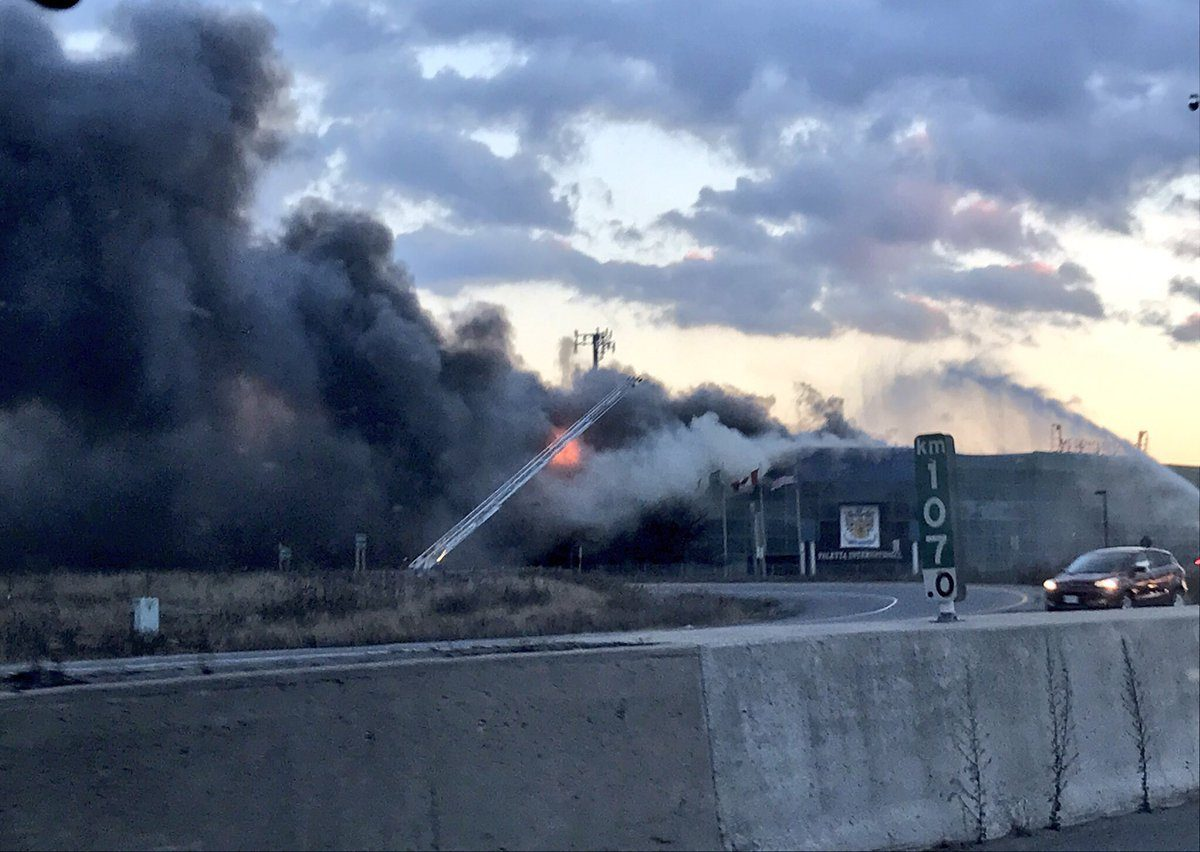 Emergency crews battling major industrial building fire in Burlington