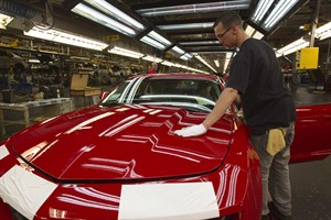 A worker checks the paint on a Camaro at the GM factory in Oshawa, Ontario on Friday, June 10, 2011. General Motors says it will move production of the Camaro from its Oshawa operation in Ontario to a plant in Michigan. THE CANADIAN PRESS/Frank Gunn