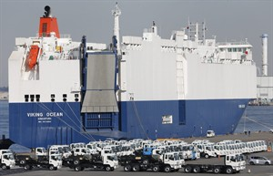 Cars for export park at a port in Yokohama, south of Tokyo, Thursday, Dec. 20, 2012. Japan is reporting its fifth straight month of trade deficits for November, marking a lengthy span of lagging exports that highlights a struggling economy. The Finance Ministry released data Wednesday, Dec. 19, showing the trade deficit soared nearly 38 percent last month compared to November the previous year. (AP Photo/Koji Sasahara)