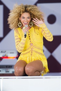 """FILE - In this July 1, 2011 file photo, Beyonce performs on ABC's """"Good Morning America"""" in New York. Through a photo contest, 100 fans will join Beyonce onstage during the singer's halftime show performance at the 2013 Super Bowl on Feb. 3, 2013, at the Mercedes-Benz Superdome in New Orleans. (AP Photo/Charles Sykes, File)"""