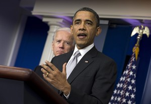 President Barack Obama gestures during a news conference to announce that Vice President Joe Biden, left, will lead an administration-wide effort to curb gun violence, in the briefing room of the White House on Wednesday, Dec. 19, 2012 in Washington. (AP Photo/ Evan Vucci)