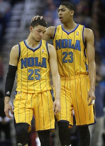 New Orleans power forward Anthony Davis (23) and shooting guard Austin Rivers (25) react during the fourth quarter of a loss to the Toronto Raptors in NBA basketball game at the New Orleans Arena in New Orleans, Friday, Dec. 28, 2012. (AP Photo/Dave Martin)