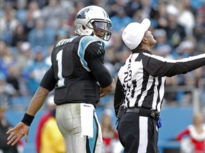 Referee Jerome Boger (23) calls an unsportsmanlike-conduct penalty on Carolina Panthers' Cam Newton (1) during the second half of an NFL football game against the Oakland Raiders in Charlotte, N.C., Sunday, Dec. 23, 2012. (AP Photo/Bob Leverone)