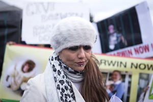 Yasmin Nakhuda stands with supporters outside an Animal Services offices in Toronto on Wednesday December 19, 2012 as she rallies support for the return of her monkey which was seized earlier this month after it was found wandering at an Ikea parking lot. THE CANADIAN PRESS/Chris Young