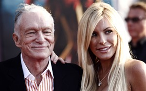 """Hugh Hefner, left, and Crystal Harris arrive at the premiere of """"Iron Man 2"""" at the El Capitan Theatre in Los Angeles, April 26, 2010. Hefner is celebrating the new year as a married man once again.The 86-year-old Playboy magazine founder exchanged vows with his """"runaway bride,"""" Harris, at a private Playboy Mansion ceremony on New Year's Eve. THE CANADIAN PRESS/AP/Matt Sayles"""