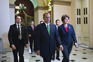 """Speaker of the House John Boehner, R-Ohio, and Rep. Cathy McMorris Rodgers, R-Wash., right, the Republican Conference Chair, arrive at the House of Representatives for the final vote on emergency legislation to avoid a national """"fiscal cliff"""" at the Capitol in Washington, Tuesday, Jan. 1, 2013. (AP Photo/J. Scott Applewhite)"""