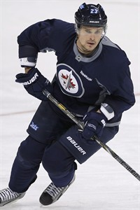 Winnipeg Jets' Alexei Ponikarovsky skates on day three of training camp in Winnipeg on January 15, 2013. The New Jersey Devils reacquired forward Alexei Ponikarovsky from the Winnipeg Jets on Wednesday for a seventh-round draft pick this year and a fourth-round pick in 2014. THE CANADIAN PRESS/John Woods