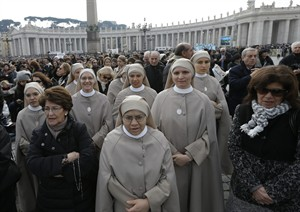 Nuns pray prior to start of Pope Benedict XVI's Angelus prayer in St. Peter's square at the Vatican, Sunday, Feb. 17, 2013. Pope Benedict XVI is blessing the faithful from his window overlooking St. Peter's Square for the first time since announcing his resignation, cheered by an emotional crowd of tens of thousands of well-wishers from around the world. (AP Photo/Alessandra Tarantino)
