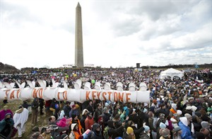 """Thousands of protestors gather at the National Mall in Washington calling on President Barack Obama to reject the Keystone XL oil pipeline from Canada, as well as act to limit carbon pollution from power plants and """"move beyond"""" coal and natural gas, Sunday, Feb. 17, 2013. (AP Photo/Manuel Balce Ceneta)"""
