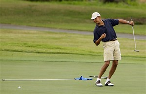 FILE - In this Dec. 31, 2009 file pohto, President Barack Obama watches the ball after making a putt on the ninth green during his golf match at Mid-Pacific County Club in Kailua, Hawaii. Obama played golf Sunday with Tiger Woods, the White House said Sunday. Once the sport's dominant player before his career was sidetracked by scandal, Woods joined Obama at the Floridian, a secluded and exclusive yacht and golf club on Florida's Treasure Coast where Obama is spending the long Presidents Day weekend. The two had met before, but Sunday was the first time they played together. (AP Photo/Chris Carlson, File)