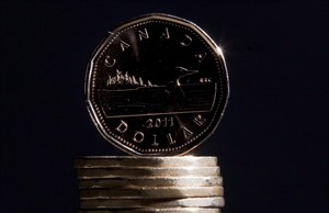 Canadian dollars (loonies) are pictured in Vancouver, on Sept. 22, 2011. THE CANADIAN PRESS/Jonathan Hayward