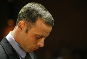 Olympic athlete Oscar Pistorius stands during his bail hearing at the magistrate court in Pretoria, South Africa, Thursday, Feb. 21, 2013. The lead investigator in the murder case against Pistorius faces attempted murder charges himself over a 2011 shooting, police said Thursday in another potentially damaging blow to the prosecution. Prosecutors said they were unaware of the charges against veteran detective Hilton Botha when they put him on the stand in court to explain why Pistorius should not be given bail in the Valentine's Day shooting death of his girlfriend. (AP Photo/Themba Hadebe)