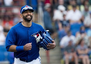 Toronto Blue Jays outfielder Jose Bautista smiles as he leaves the game after playing against the Baltimore Orioles during fifth inning MLB Grapefruit League baseball action Dunedin, Fla., on Sunday, Feb. 24, 2013. THE CANADIAN PRESS/Nathan Denette