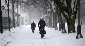 Pedestrians make their way through the snow during a storm in the nation's capital on Wednesday Feb. 27, 2013 in Ottawa. THE CANADIAN PRESS/Sean Kilpatrick