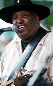 "FILE - In this July 5, 2009 file photo, Bluesman Magic Slim performs with his band ""The Teardrops"" on the final day of the Waterfront Blues Festival in Portland, Ore. Slim, a contemporary of blues greats Muddy Waters and Howlin' Wolf who helped shape the sound of the Chicago blues, died Thursday, Feb. 21, 2013. He was 75.(AP Photo/Greg Wahl-Stephens, File)"