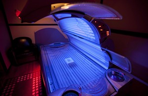 A tanning bed is shown in North Vancouver, B.C. Tuesday, March, 20, 2012. It's not yet moving to the sometimes hideous pictorial warning labels seen on cigarette packaging, but Ottawa wants to get the message across that tanning beds can be hazardous to your health. THE CANADIAN PRESS/Jonathan Hayward