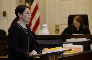 York County Deputy District Attorney Justina McGettigan gives her opening statements in York County Superior Court, Alfred, Maine, Wednesday, Feb. 20, 2013, during the trial of Mark Strong Sr. Strong is accused of helping Alexis Wright run a one-woman prostitution business from a Kennebunk dance studio. (AP Photo/Portland Press Herald, Shawn Patrick Ouellette)