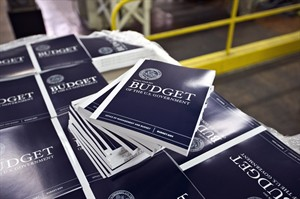 FILE - In this April 8, 2013, photo, copies of President Barack Obama's budget plan for fiscal year 2014 are prepared for delivery at the U.S. Government Printing Office in Washington. The Treasury reports on the budget deficit for June on July 10, 2013. (AP Photo/J. Scott Applewhite, File)