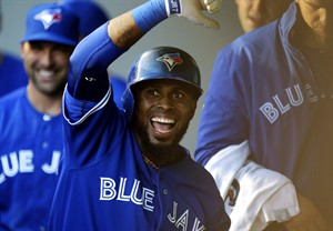 Toronto Blue Jays' Jose Reyes celebrates in the dugout after he hit a solo home run off of Seattle Mariners starting pitcher Felix Hernandez in the first inning of a baseball game, Tuesday, Aug. 6, 2013, in Seattle. (AP Photo/Ted S. Warren)