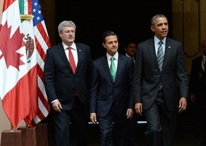 Prime Minister Stephen Harper, left to right, walks with Mexican President Enrique Pena Nieto and US President Barack Obama as they arrive to a trilateral meeting during the North American Leaders Summit in Toluca, Mexico on Wednesday, February 19, 2014. THE CANADIAN PRESS/Sean Kilpatrick
