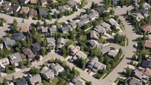 Aerial views of housing in Calgary on June 22, 2013. Calgary new home prices are down for the first time in more than three years after months of economic pressure from low oil prices. THE CANADIAN PRESS/Jonathan Hayward