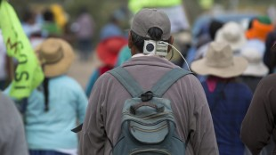 A farmer opposed to a mining project listens a little radio during a protest in Cocachacra, Peru, Friday, May 15, 2015. Farmers and local leaders fear the $1.3 billion Tia Maria open-pit mine will contaminate irrigation water in the rice farming-rich Tambo valley on Peru's desert coast. Thousands have mobilized against the project, which is owned by Southern Peru Copper Corp., a subsidiary of Grupo Mexico. (AP Photo/Martin Mejia)