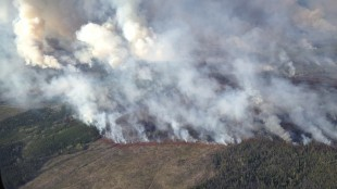 The Little Bobtail Lake fire, 50 kilometres southwest of Prince George, B.C., is shown on Sunday, May 10, 2015. A large forest fire in northern B.C. is growing as firefighters struggle to contain the out-of-control blaze that has forced dozens of people from their homes. THE CANADIAN PRESS/HO - British Columbia Wildfire Management Branch