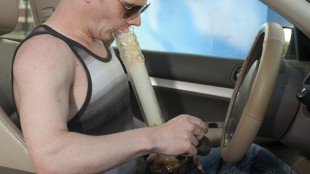 Michael Wileniec, a high-school student with a rare bone disease who has a prescription for medical marijuana, smokes marijuana in his car in a parking lot close to his high school after it is closed in Saskatoon, Friday,May 15, 2015. THE CANADIAN PRESS/Liam Richards