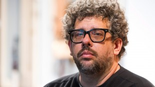"FILE - In this May 1, 2015 photo, Neil LaBute poses on the set of his new play ""The Way We Get By"" at the Second Stage Theatre in New York. A play festival benefiting the National Coalition Against Censorship will go on at a new location, but without the Neil LaBute play that led to the event being scrapped at its initial venue. Playwrights for a Cause said Tuesday that its festival featuring three new short plays about censorship in the arts will take place on June 14 at New York Theatre Workshop. (Photo by Charles Sykes/Invision/AP, File)"