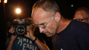 Douglas Garland is escorted into a Calgary police station in connection with the disappearance of Nathan O'Brien and his grandparents in Calgary, Alta., on July 14, 2014. A preliminary hearing is to begin today for a man accused of killing a five-year-old Calgary boy and his grandparents. Douglas Garland, who is 55, faces two counts of first-degree murder in the deaths of Alvin and Kathy Liknes and one charge of second-degree murder in the death of Nathan O'Brien. THE CANADIAN PRESS/Jeff McIntosh