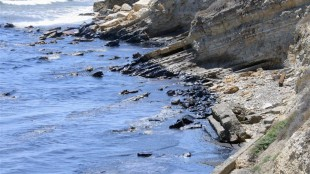 This photo provided by the Santa Barbara County Fire Department shows an oil slick from a broken pipeline off the central California coast near Santa Barbara on Tuesday, May 19, 2015. Capt. Dave Zaniboni of the Santa Barbara County Fire Department says the pipeline on the land near Refugio State Beach broke Tuesday and spilled oil into a culvert that ran under the U.S. 101 freeway and into the ocean. (Mike Eliason/Santa Barbara County Fire Department via AP)