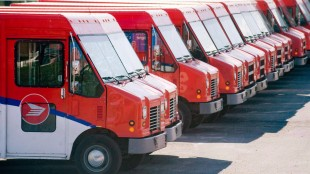 Canada Post vehicles sit outside a sorting depot in the Ville St-Laurent borough of Montreal on June 6, 2011. Canada Post's plan to end home mail delivery would become a dead letter if the NDP were to win the federal election this fall. THE CANADIAN PRESS/Graham Hughes