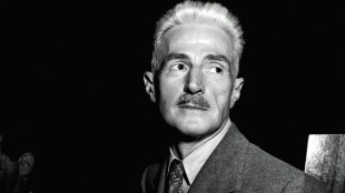 """In this Nov. 7, 1947 file photo, novelist Dashiell Hammett, author of """"The Maltese Falcon"""" and """"The Thin Man,"""" appears in New York. A literary treasure trove of Hammett's work is finding a home at the University of South Carolina. It is the largest collection known of letters, photos, publications and books by the Hammett and will be available to scholars and students within the year. (AP Photo)"""