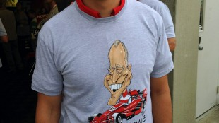 """Graham Rahal, a member of the Rahal Letterman Lanigan (RLL) racing team, poses wearing a (hash)thanksdave t-shirt before the start of the Indianapolis 500 on Sunday, May 24, 2015, at the Indianapolis Motor Speedway in Indianapolis. Letterman's IndyCar team paid tribute to the former """"Late Show"""" host by putting a caricature of his face and (hash)thanksdave on driver Oriol Servia's yellow car for Sunday's race. (AP Photo/Dan Gelston)"""