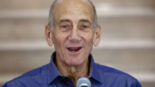 FILE - In this July 10, 2012 file photo, Former Israeli Prime Minister Ehud Olmert speaks to the media after hearing the verdict in his trial, in Jerusalem's District Court. Olmert has been sentenced to eight months in prison for unlawfully accepting money from a U.S. supporter. The Monday, May 25, 2015, verdict in Jerusalem District Court caps a dramatic downfall of a man who only years earlier led the country and hoped to bring about a historic peace agreement with the Palestinians. (AP Photo/Ariel Schalit, File)