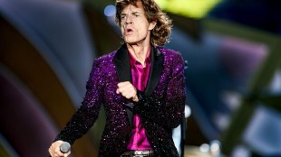 Mick Jagger performs at The Rolling Stones Zip Code Tour opening night at Petco Park on Sunday, May 24, 2015, in San Diego. (Photo by Rich Fury/Invision/AP)