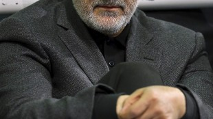 """FILE - In this Friday, March 27, 2015 file photo released by an official website of the office of the Iranian supreme leader, commander of Iran's Quds Force, Qassem Soleimani, sits in a religious ceremony at a mosque in the residence of Supreme Leader Ayatollah Ali Khamenei, in Tehran, Iran. The chief of an elite unit in Iran's Revolutionary Guard has accused the U.S. of having """"no will"""" to stop the Islamic State group after the fall of the Iraqi city of Ramadi, an Iranian newspaper reported Monday, May 25, 2015. (Office of the Iranian Supreme Leader via AP, File)"""