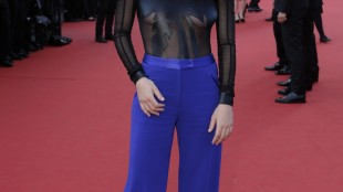 Actress Charlotte Vandermeersch poses for photographers upon arrival for the screening of the film The Little Prince at the 68th international film festival, Cannes, southern France, Friday, May 22, 2015. (AP Photo/Thibault Camus)