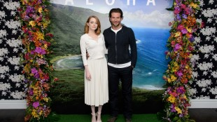 """FILE - In this Saturday, May 16, 2015, file photo, U.S actors Emma Stone, left, and Bradley Cooper pose for photographers at a photo call for the film, """"Aloha,"""" in London. The Sony Pictures romantic comedy, which releases in U.S. theaters on May 29, 2015, is drawing criticism in Hawaii, where it was filmed. Some Native Hawaiians, including the state's film commissioner, are taking issue with using a Hawaiian word to title a mainstream Hollywood movie. (Photo by Jonathan Short/Invision/AP, File)"""