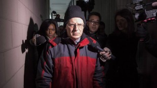 Former Ontario deputy education minister Benjamin Levin leaves a Toronto court on March 3 2015, after pleading guilty to three charges relating to child pornography. THE CANADIAN PRESS/Chris Young