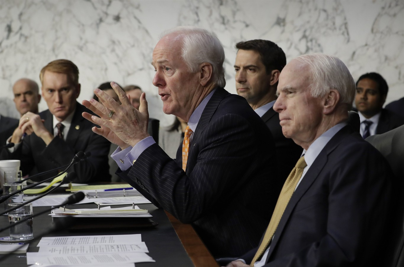 McCain blames confusing questions on lack of sleep